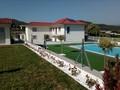 Moradia nova V4 para venda Ossela Oliveira de Azeméis - ar condicionado, jardins, piscina, garagem, condomínio fechado, cozinha equipada, alarme, varandas, parqueamento