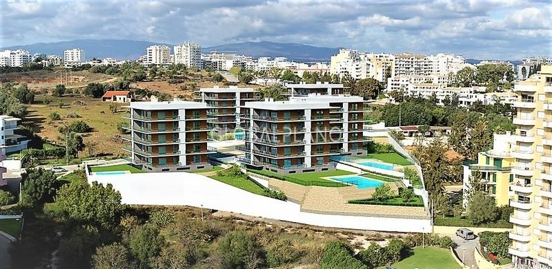 Apartamento de luxo T1 Praia da Rocha Portimão - ar condicionado, condomínio fechado, chão radiante, piscina, lugar de garagem, jardim