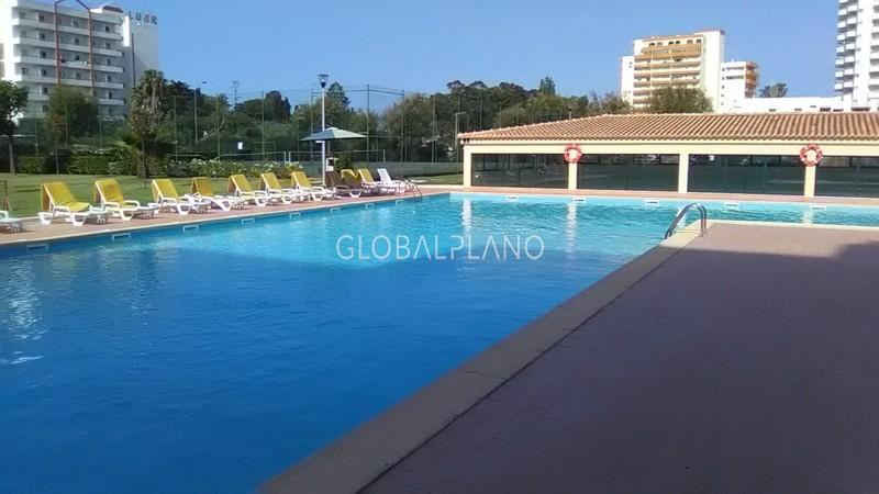 Apartamento T1 Praia da Rocha Portimão - varanda, ténis, piscina, condomínio privado, bbq, garagem, jardim, mobilado, ar condicionado