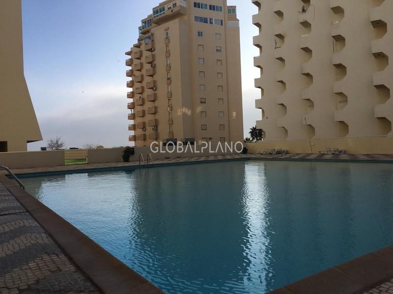 Apartamento T0+1 Praia da Rocha Portimão - piscina, mobilado, equipado, lugar de garagem