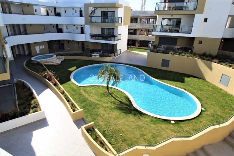 Apartment nuevo T1 Alvor Portimão - gated community, balconies, garage, solar panels, air conditioning, green areas, balcony, swimming pool, equipped