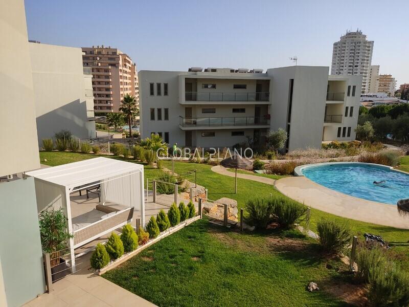 Apartamento T1 Praia da Rocha Portimão - condomínio fechado, terraço, jardins, equipado, piscina, ar condicionado, garagem