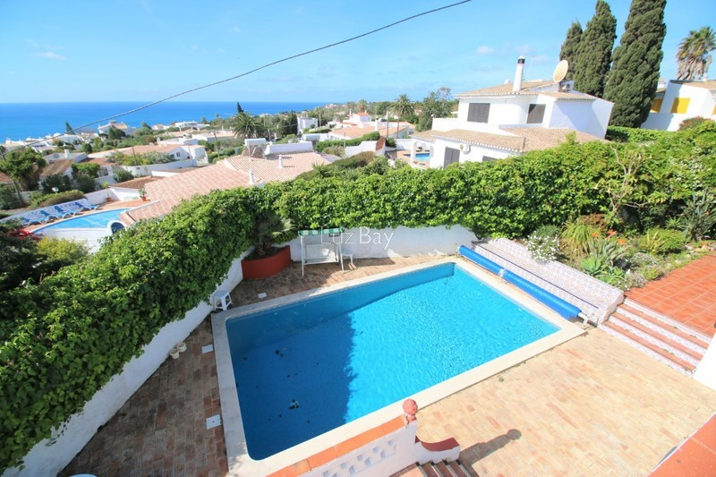 House V3 Praia da Luz Lagos - fireplace, terrace, barbecue, equipped kitchen, terraces, garage, sea view, swimming pool, gardens, garden