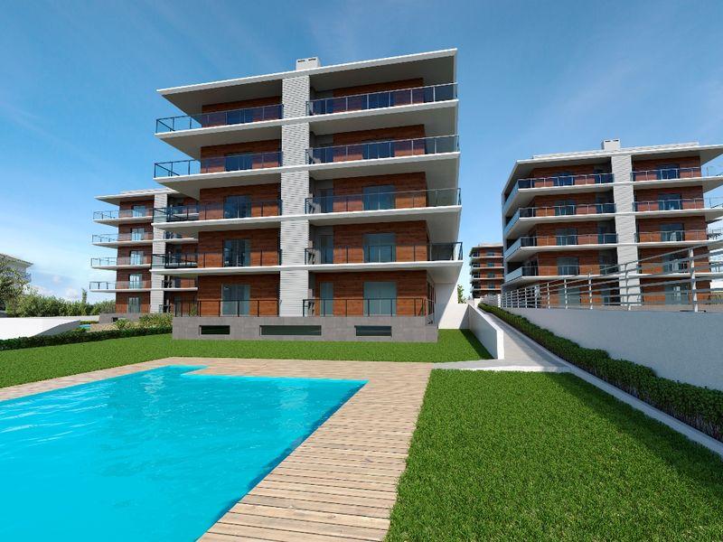 Apartamento T2 novo Praia da Rocha Portimão - vista mar, varandas, jardins, piscina