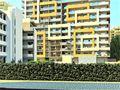 Apartamento T1 de luxo em construção Praia da Rocha Portimão à venda - equipado, garagem, sauna, piscina, banho turco, ténis, parque infantil, isolamento térmico, videovigilância, chão radiante, painéis solares, jardim, condomínio fechado, varandas