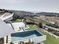 Moradia nova V4 Albufeira para comprar - varandas, garagem, jardim, piscina, vista mar